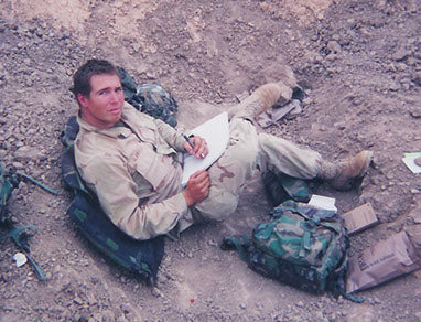 Glanville serving with the 1st Battalion, 5th Marine Regiment in Iraq as a Navy Corpsman. May, 2003