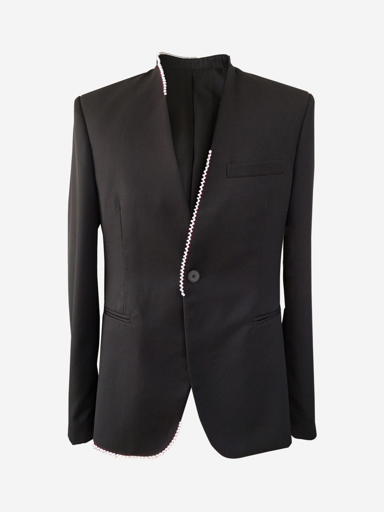 Black collarless mens suit jacket with white beads
