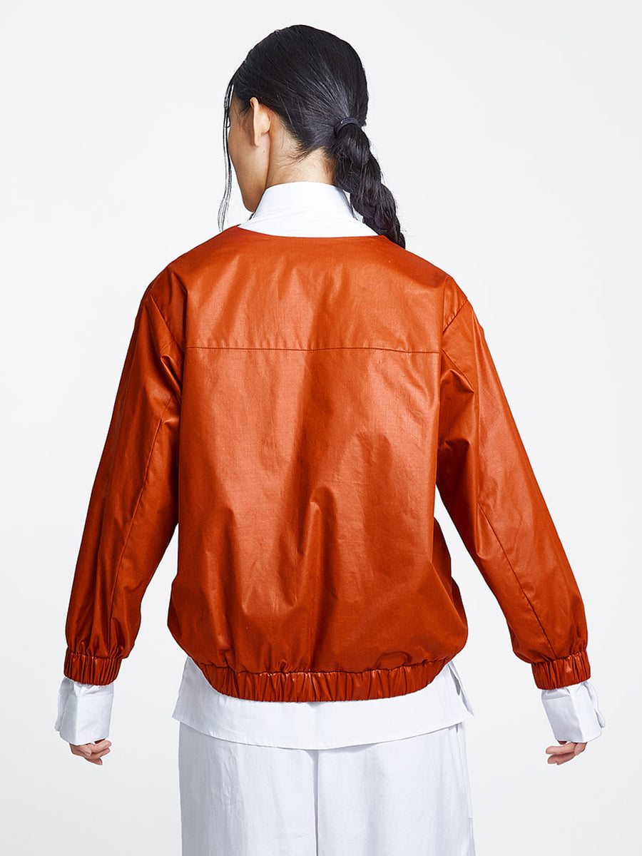 Burnt orange jacket on model back view