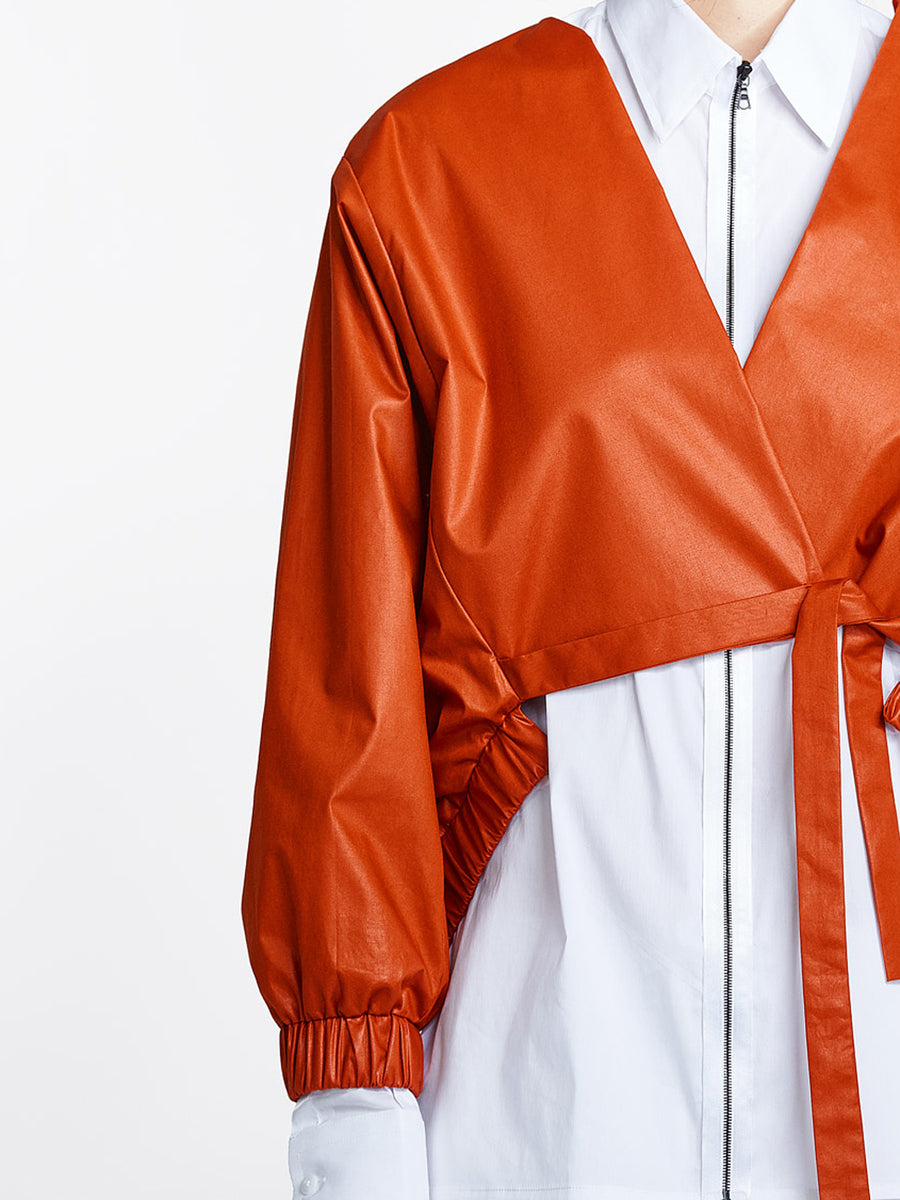 Burnt orange jacket on model detail