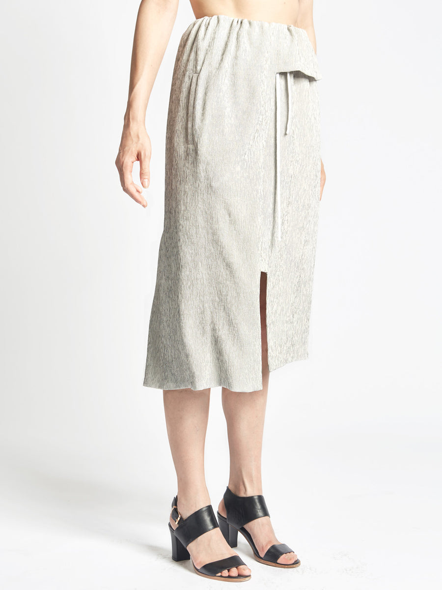 Gray silk micropleated overlap skirt with drawstring waist and pockets