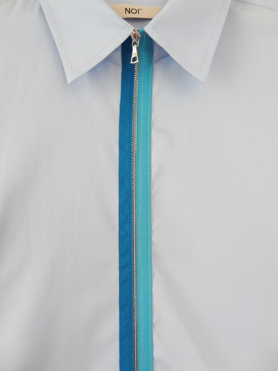 Men's blue cotton collared shirt with blue two-tone metal zipper.