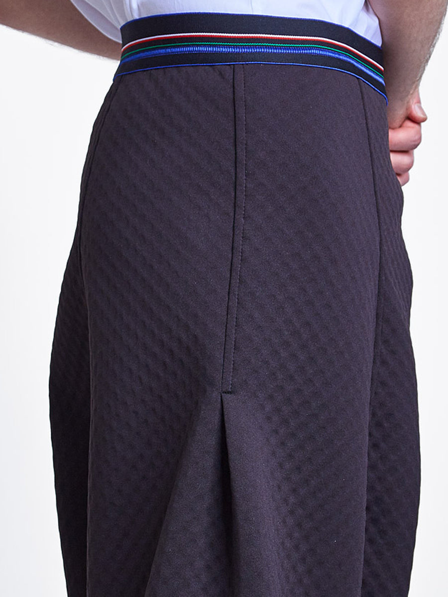 Unisex black bubble neoprene drop crotch pant with striped elastic waistband.