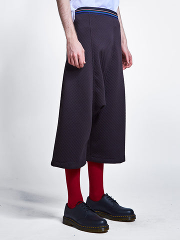 Drop crotch pant in bubble neoprene and striped elastic waistband.