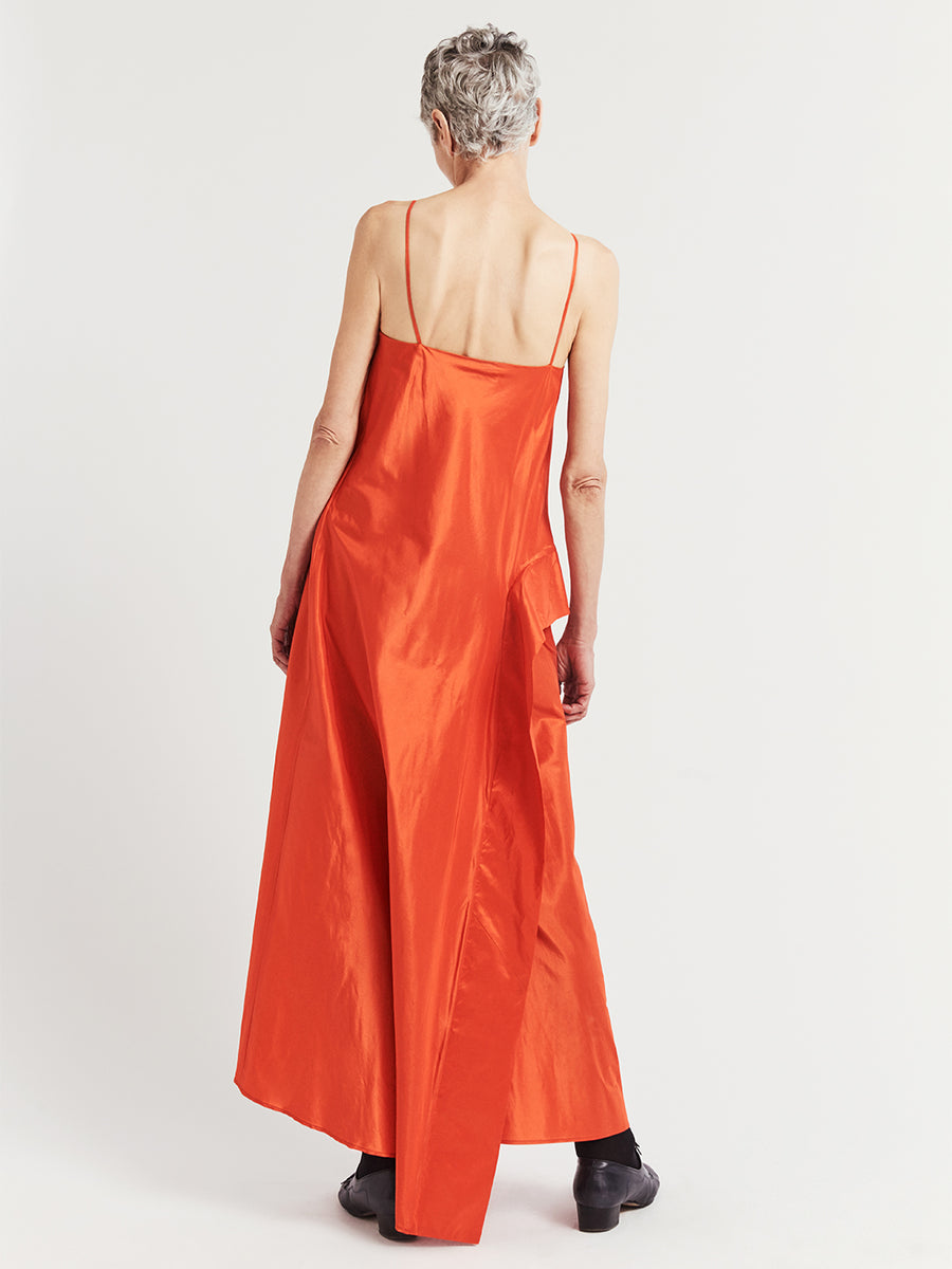 Back view of bright orange silk taffeta asymmetric long evening dress