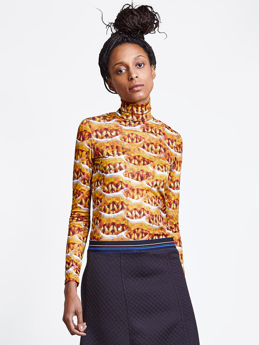 womens back zipper turtleneck in orange print
