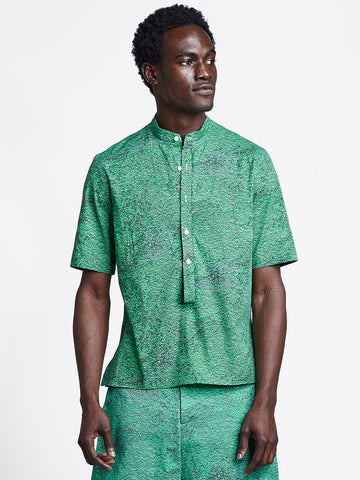 Loop placket short sleeve men's shirt in green print on model