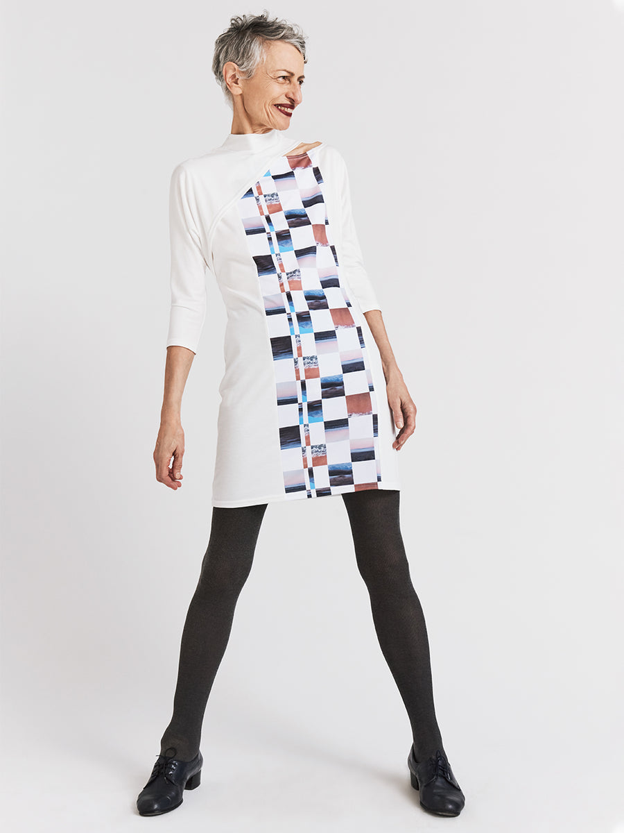 White jersey designer dress with split dolman sleeves, original print, and mock turtleneck.