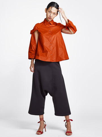 burnt orange topsy turvy shirt with exposed arms
