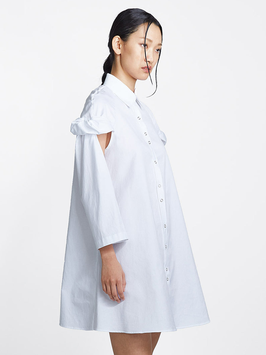 white cotton topsy turvy shirtdress with exposed arms