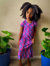 Load image into Gallery viewer, Image of Black child in pink and blue dress