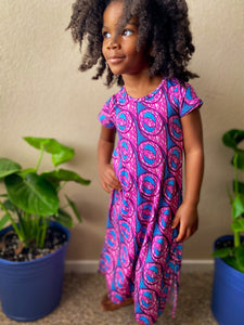 Image of Black child in pink and blue dress