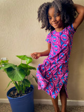 Load image into Gallery viewer, Image of Black child in pink and blue dress with a plant