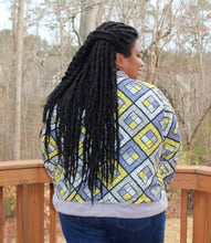 Load image into Gallery viewer, Image of beautiful Black woman in yellow and grey bomber jacket