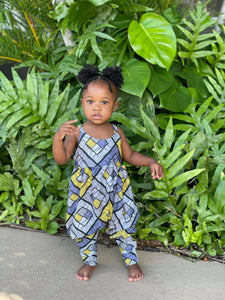 Image of beautiful Black toddler in yellow and grey romper