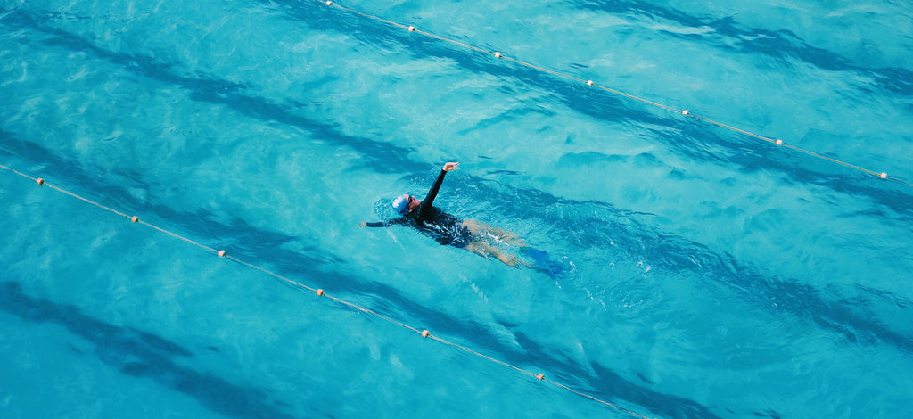 Solo Swimmer in the pool, enjoying the meditational effects of swimming