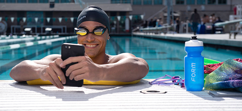 Miguel Chavez swimming with the FORM Smart Swim Goggles