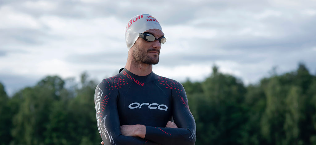 Richard Murray wearing a wetsuit and the FORM Smart Swim Goggles