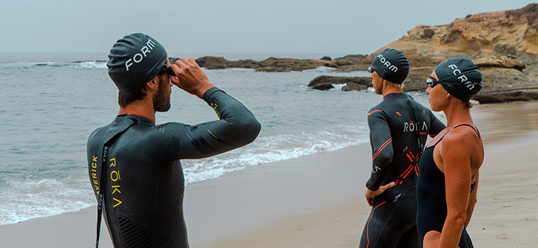 group of swimmers preparing for open water