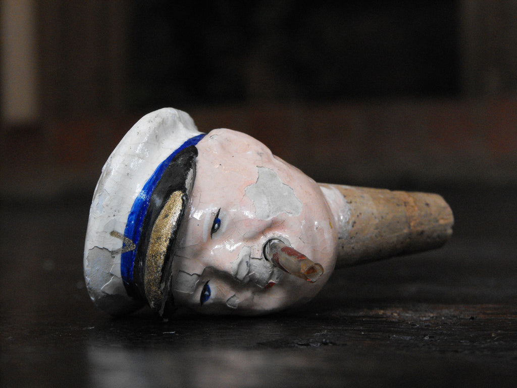 A 1920's Papier-Mache & Cork Bottle Stopper of Winston Churchill