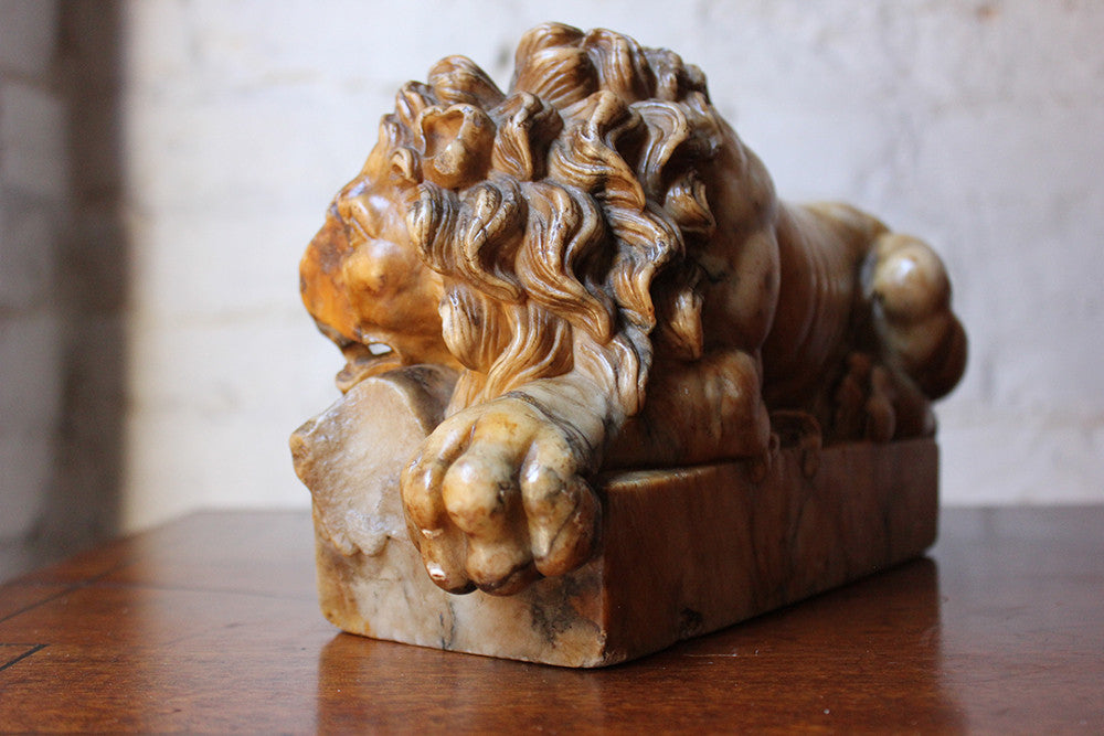 An Extremely Fine Italian Grand Tour Carved Giallo di Siena Marble Lion c.1810-20; After Antonio Canova (1757-1822)