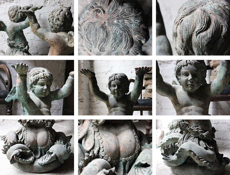 A Wonderful Pair of 19thC Cast Iron Relief Garden Ornaments in the Form of Winged Putto Sea-Creatures