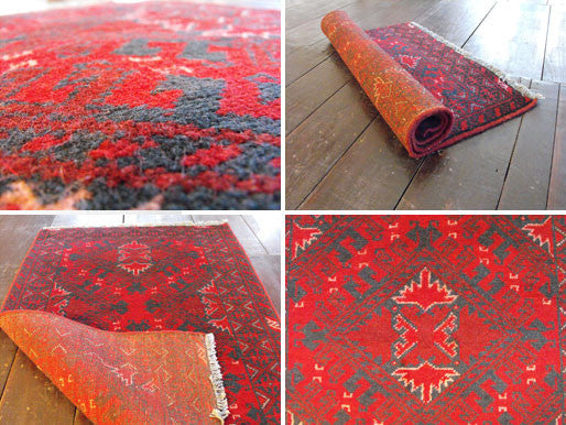 A Durable Red Afghan Rug: 119cm x 77cm