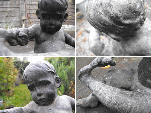 A Whimsical English School Lead Sculpture in the form of a Young Boy Pulling His Sock Off