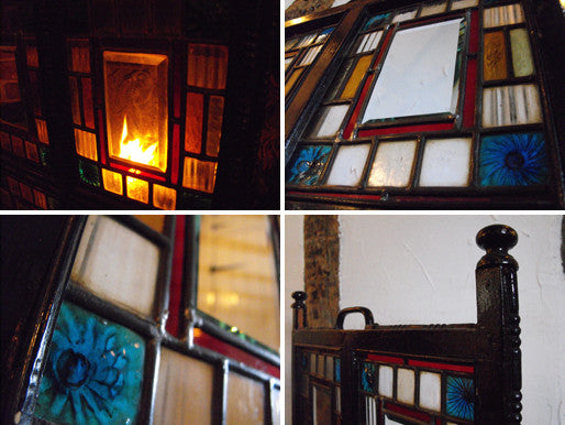 An Arts and Crafts Coloured Glass & Ebonised Fire Screen
