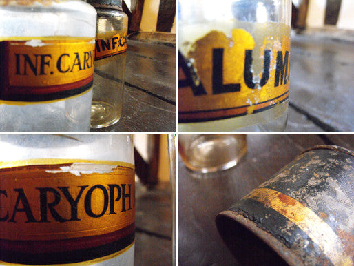 Two Late 19thC Glass Apothecary Bottles with Tin Caps and Painted Banners for Clove Water and Calumba Root