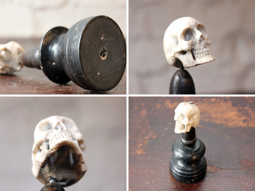 A Curious Early 20thC Miniature Carved Bone Model of a Human Skull Upon an Ebonised Column