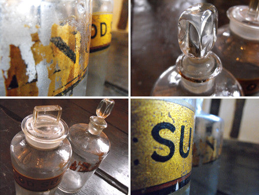 Two Late 19thC Glass Apothecary Bottles with Painted Gold Banners, One for Sodium Sulphate