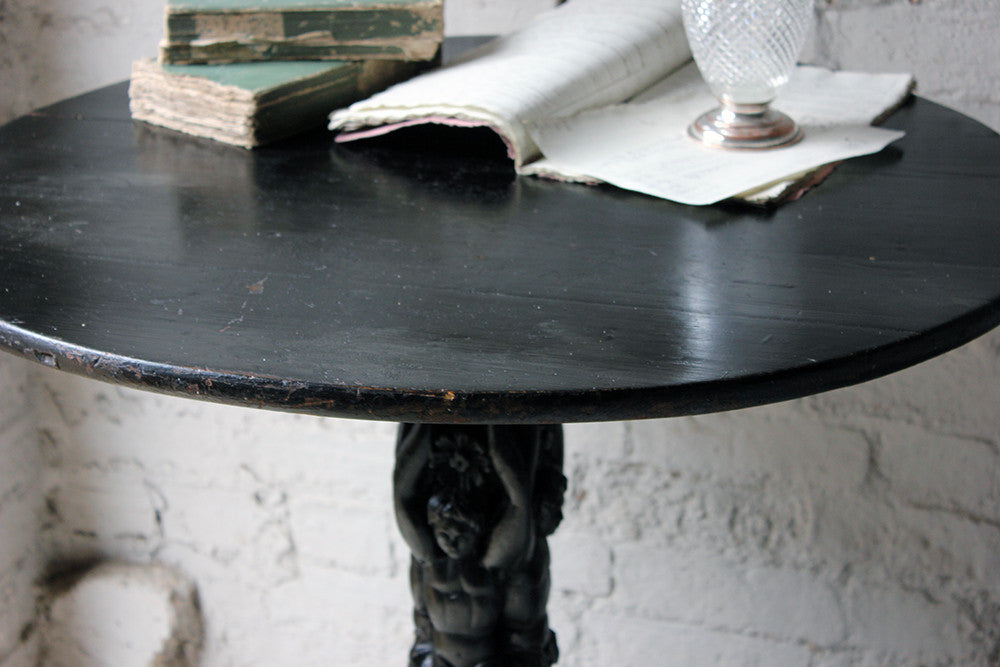 A Primitively Carved Ebonised Pine Circular Figural Pedestal Table c.1890