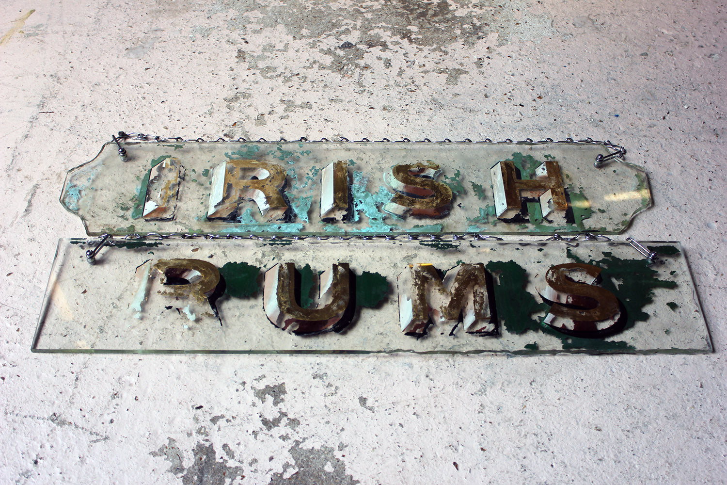 A Pair of c.1900 Reverse Glass Painted Publican Advertising Signs for Irish Rums