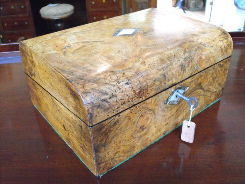 A Victorian Semi Domed Figured Walnut Writing Slope with Amboyna & Mother of Pearl