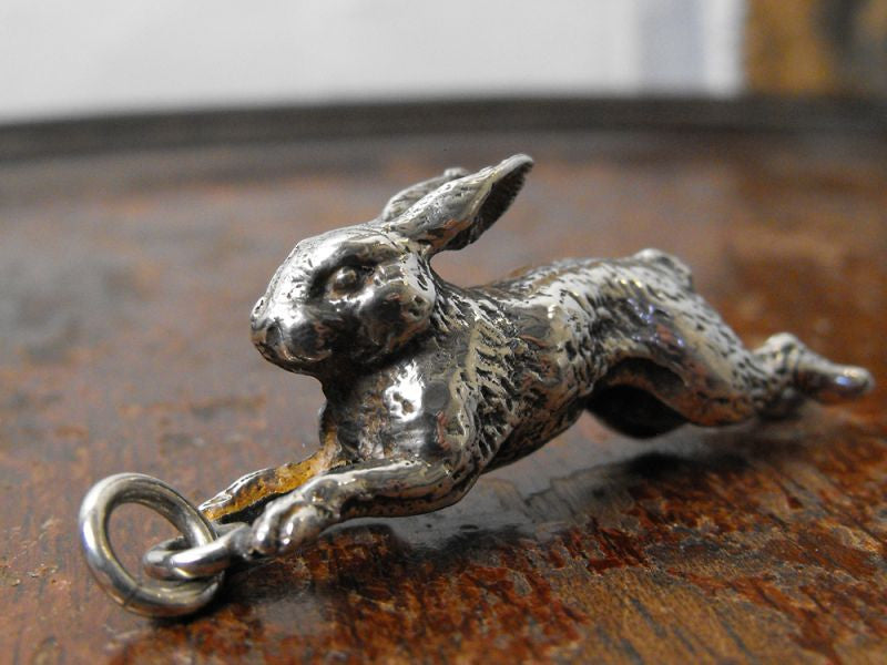 A Delightful Cast Silver Plate Charm Pendant Formed as a Running Hare