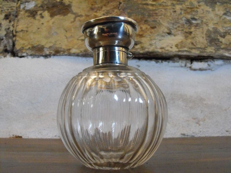 An Elegant Victorian Spherical Cut Glass Crystal Perfume Bottle with Silver Collar & Top