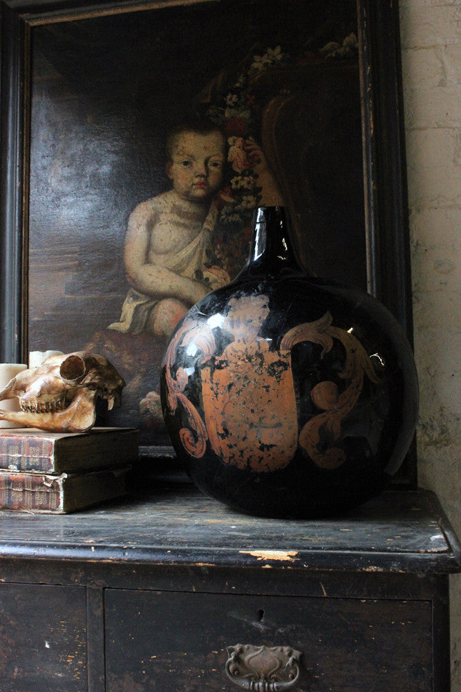 A Large 18thC Olive Glass Gilt Painted Wine Bottle