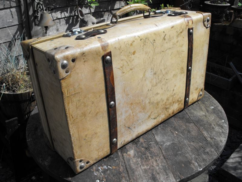 An Edwardian Cream Leather Travelling Suitcase of Drew & Sons, Piccadilly Circus, London