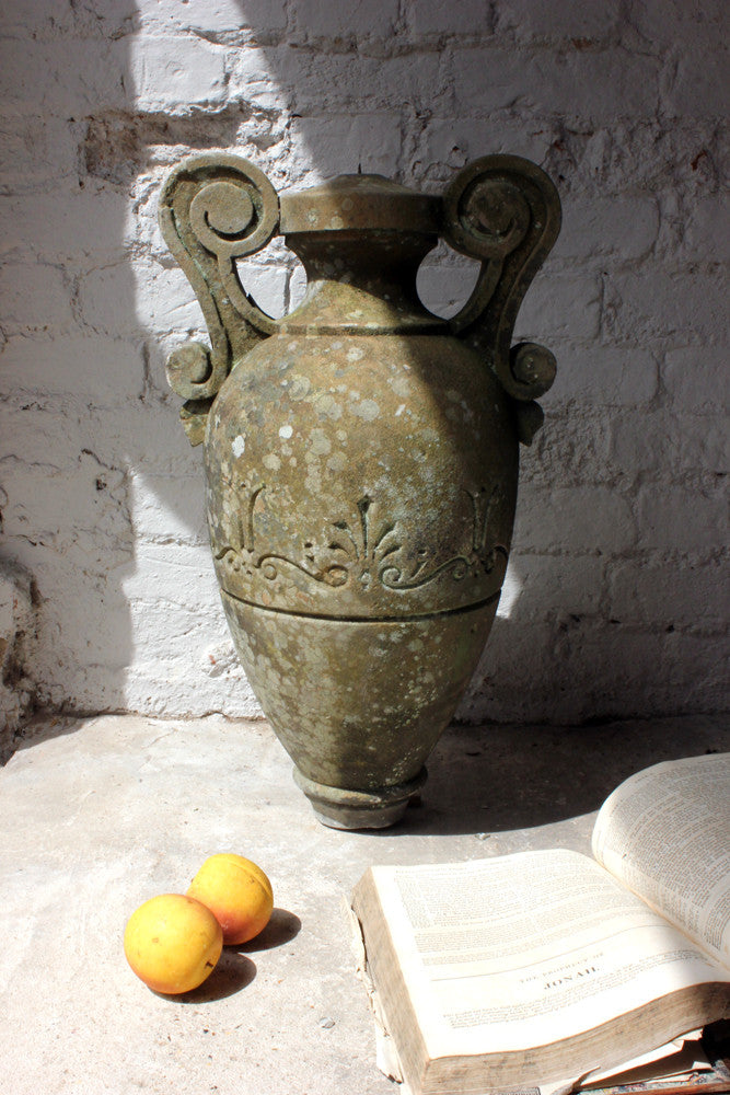 An unusual carved c stone carving of a roman amphora