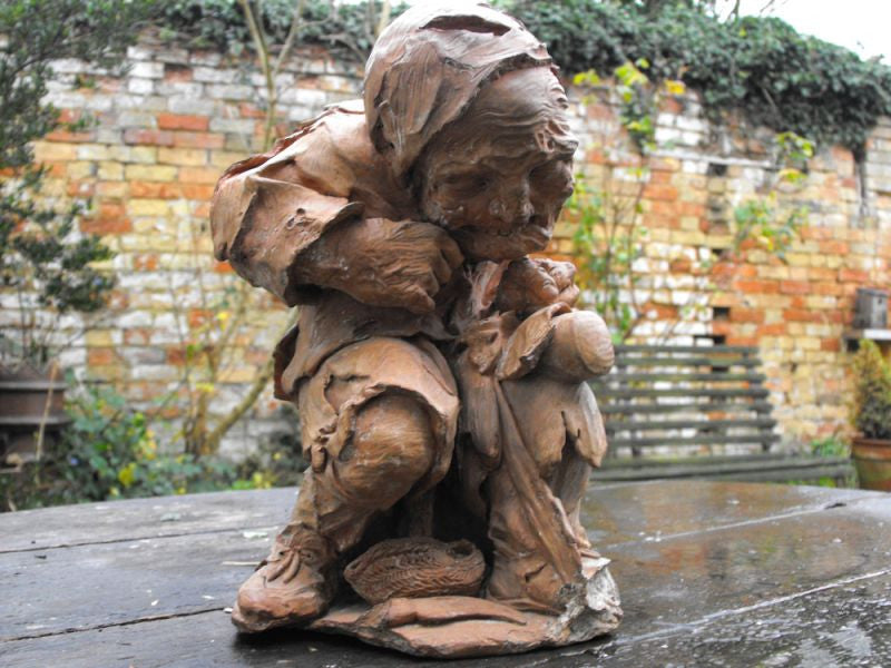 A Unique Terracotta Sculptured Figure of a Hunchbacked Tradesman c.1940