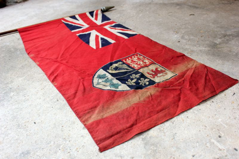 A Good British Empire Early 20thC Canadian Red Ensign Flag Mounted on a Pole