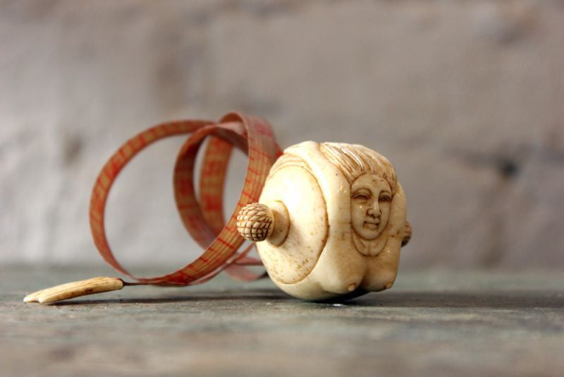 A Fine Early 20thC Carved Bone Novelty Tape Measure in the Form of a Mermaid