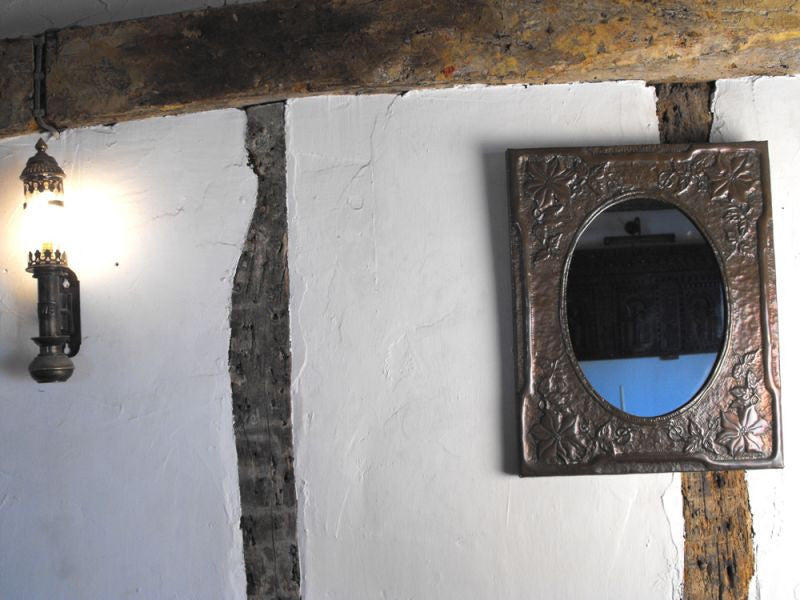 A Beautiful Arts and Crafts Embossed Copper Framed Wall Mirror