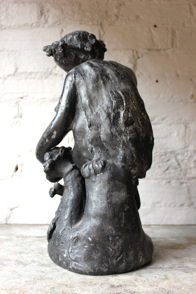 A Beautiful George III Period Lead Garden Ornament Cast as a Bacchanalian Putto