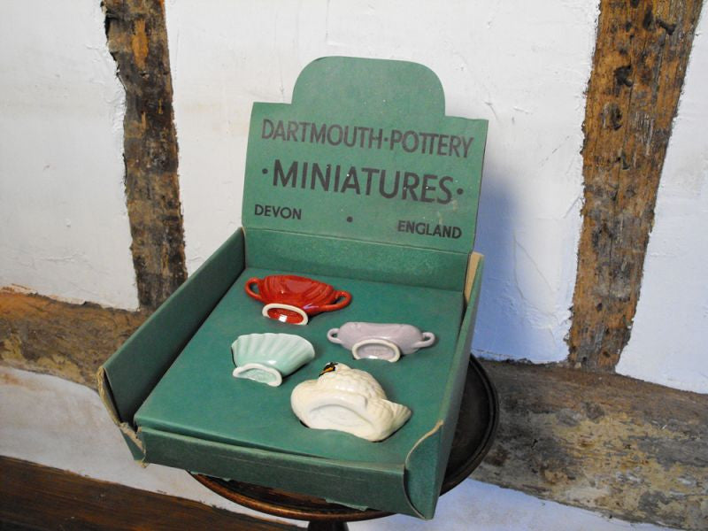 An Early Four Piece Shop Display Collection of Dartmouth Pottery Miniatures