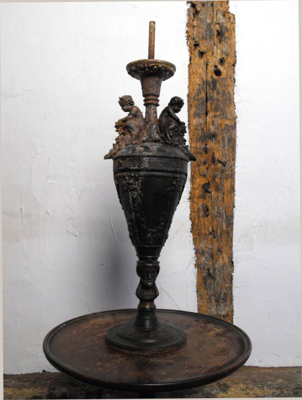 A Classical Form Spelter Lamp with Putti & Grapes above Bacchus Heads