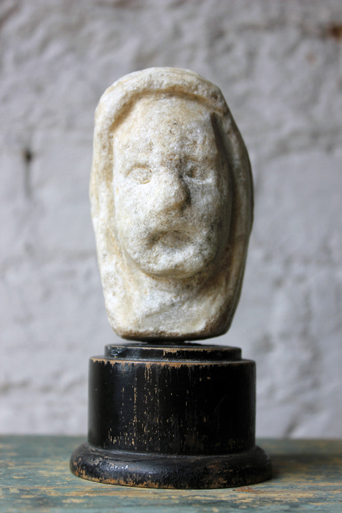 A Small Medieval Marble Cowled Head on Ebonised Stand c.1200-1400