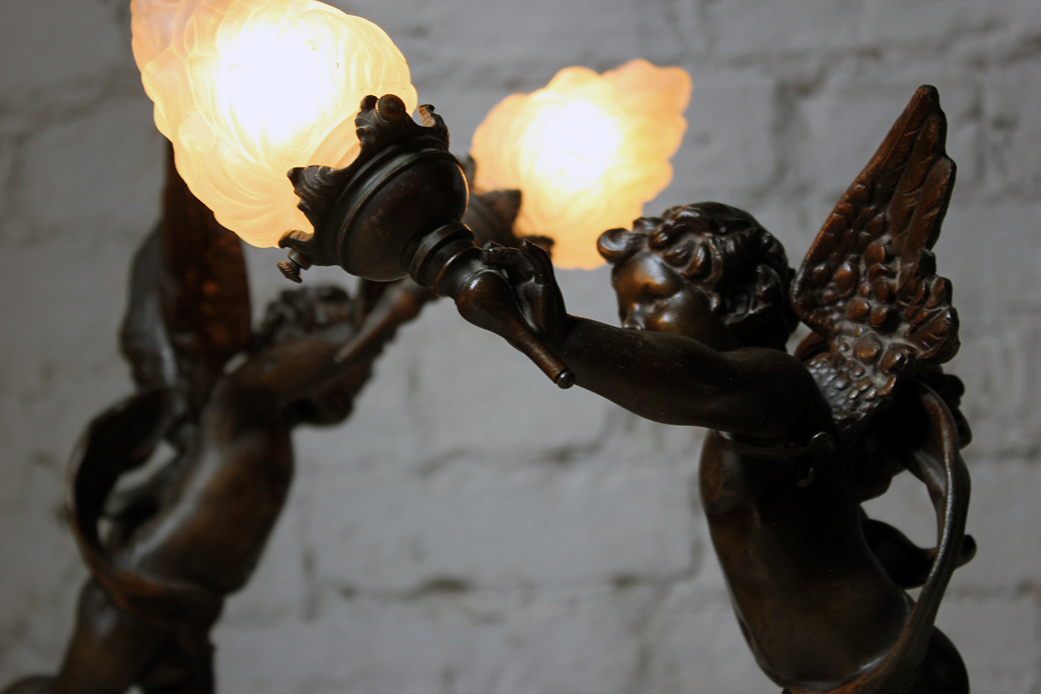 After Emile Bruchon (1806-1895); 'L'Amour Vainquer' & 'L'Amour Vagabond'; An Attractive Pair of French Spelter & Marble Table Lamps Modelled as Winged Cherubs c.1915