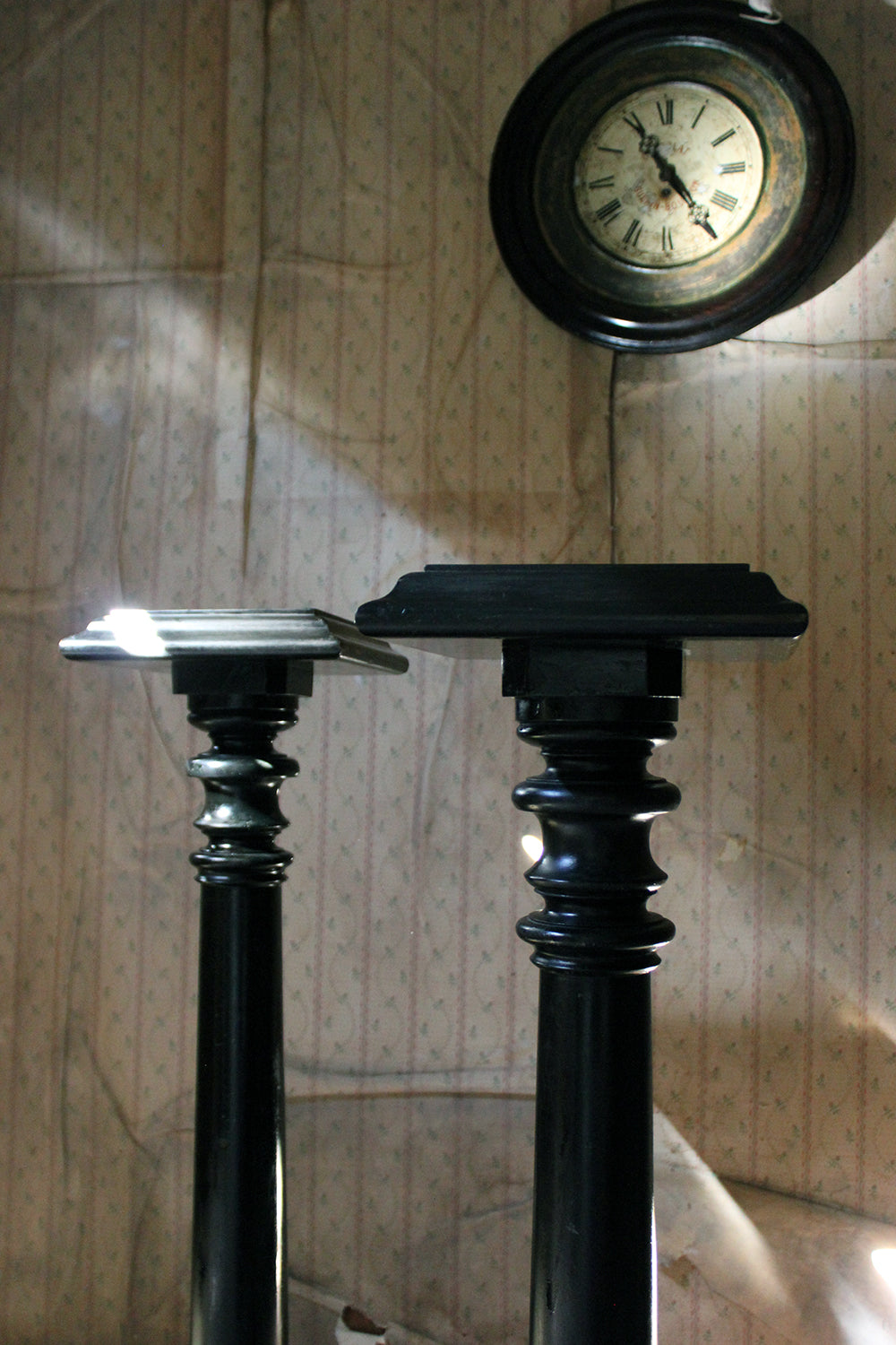 A Pair of Late Victorian Ebonised Torchère Stands c.1880